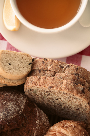Breakfast with healthy brown bread and black tea.