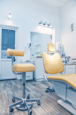 Dental instruments and tools in a dentists office. Detail of medical chair at local private clinic. Stock Photo