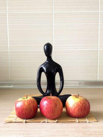 put forward: Sculpture dolls  seat on wooden mat, Apple put forward.