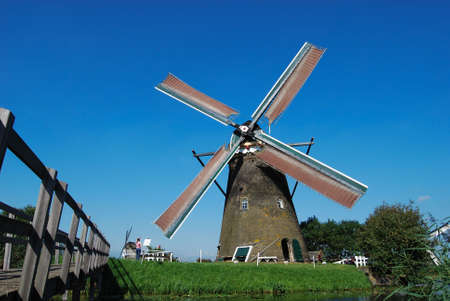 Dutch mill on the waterside with nice wether photo
