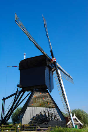 Dutch mill on the grass with nice wether photo