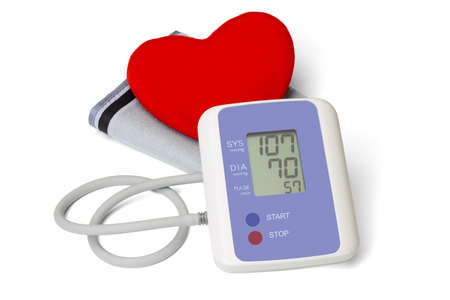 Digital blood pressure meter with love heart symbol on white background photo