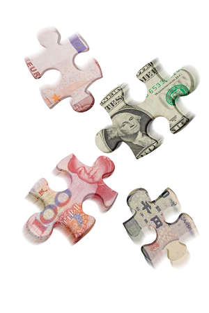 superimposed: Mismatched jigsaw puzzles superimposed with world major currencies on white background Stock Photo