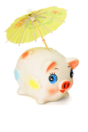 Saving for raining days - Cute piggy bank with colorful umbrella on white background photo