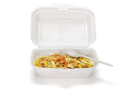 Fried rice in box with plastic disposable spoon on white background photo