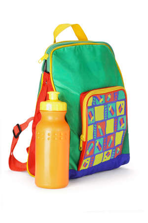 back packs: Colorful preschooler backpack and plastic water container on white background