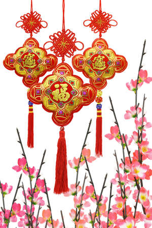 hang up: Chinese New Year traditional ornaments and plum blossom on white background Stock Photo