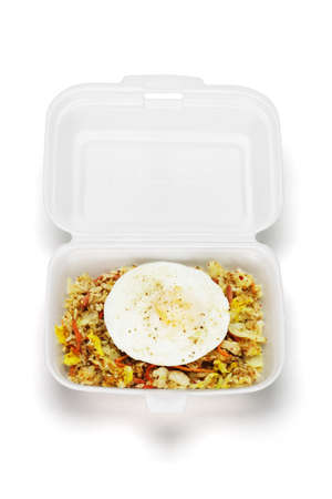 Spicy fried rice with egg in open box on white background Stock Photo - 9590281