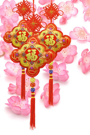 Chinese new year traditional ornaments on cherry blossom background photo