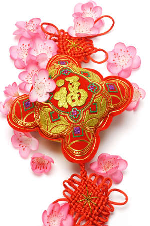 Chinese new year ornament and cherry blossom on white background photo