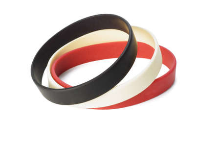 Colorful elastic wrist bands on white background  photo
