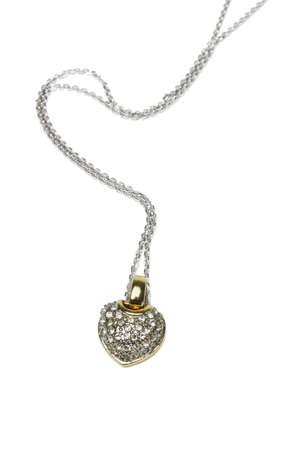 Heart shaped gemstone necklace on white background photo