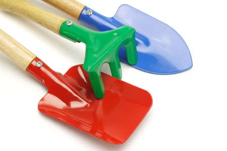 Close up of toy gardening tools on white background Stock Photo - 9593397