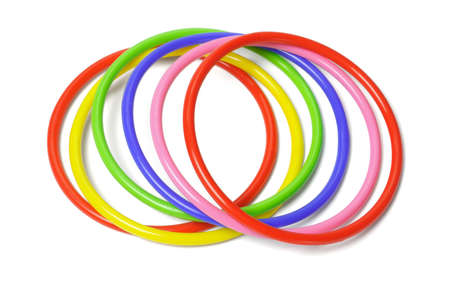 multicolor plastic bangles arranged on white background photo