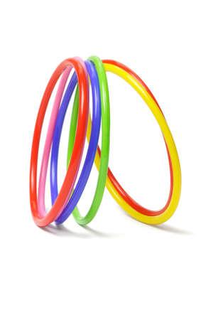 multicolor plastic bangles arranged on white background Stock Photo - 9593241