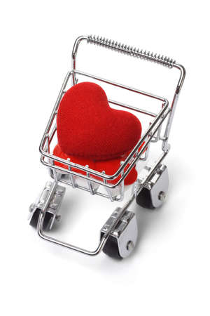 Love heart shape symbol in shopping cart on white background photo