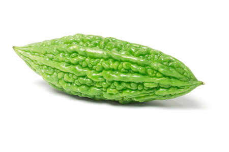 bitter fruit: Fresh green bitter gourd on white background Stock Photo