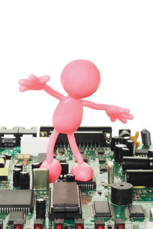 Rubber figurine playing on electronic circuit board with copy space Stock Photo - 9766573