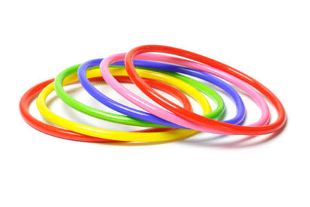 Multicolor plastic bangles isolated on white background Stock Photo - 9766402