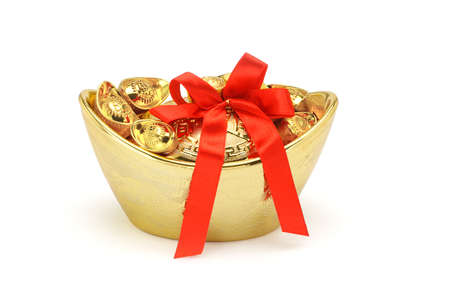 ingots: Chinese New Year gold decorative ingots with red bow ribbon on white background