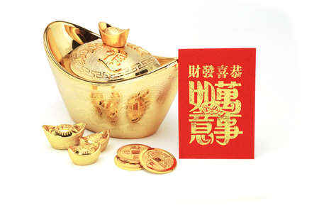 Chinese new year gold ingots and red packet on white background photo