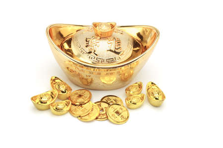Chinese new year gold coins and ingots ornament on white photo