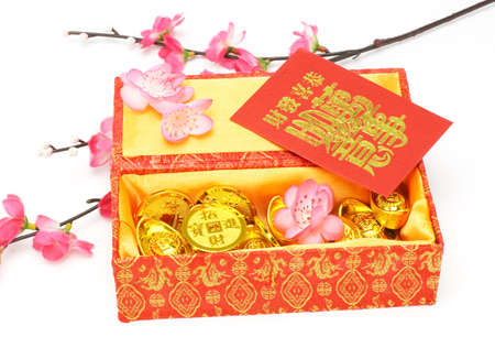 ingots: Chinese new year gift box, red packets and ornaments on white background  Stock Photo