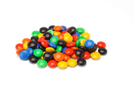 Colorful assortment of Chocolate button candies on white background photo