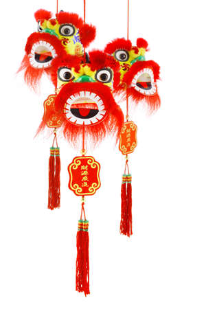 customs and celebrations: Three hanging Chinese new year lion head ornaments on white background Stock Photo