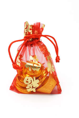 ingots: Chinese new year gold ingots and coins in red decorative sachet on white background Stock Photo