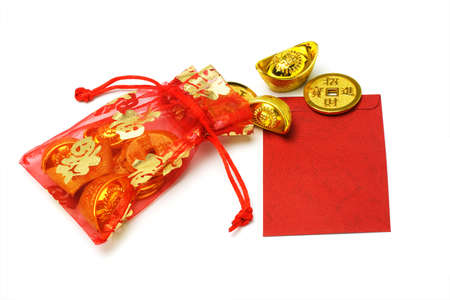 ingots: Chinese new year gold ingots and coins in red sachet and red packet on white background