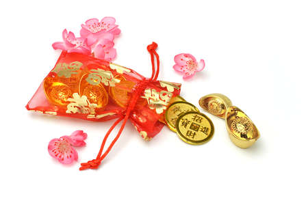Bag of gold coins: Chinese new year gold ingots and coins in red sachet on white background