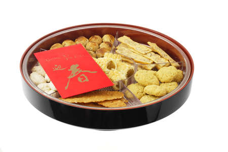 almond biscuit: Chinese new year snack tray with assortment of cookies and red packet