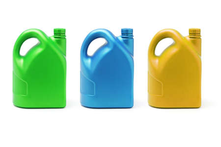 Three color containers of lubricant on white background photo