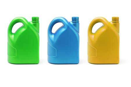petrol can: Tres contenedores de color de lubricante sobre fondo blanco