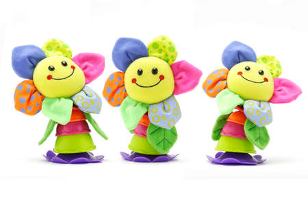 three colors: Three sunflower smiley face dolls on white background