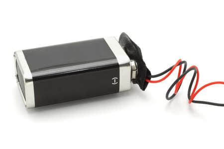 electrolyte: 9v battery attached to connector on white background