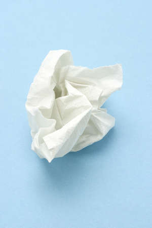 facial tissue: Crumpled two ply tissue paper on blue seamless background Stock Photo