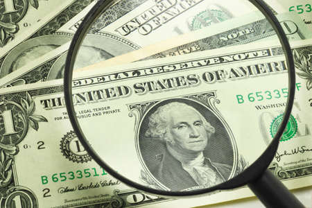 scrutiny: US dollars brighten under magnifying glass scrutiny