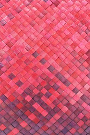 Close up of colored woven palm leaves mat background photo
