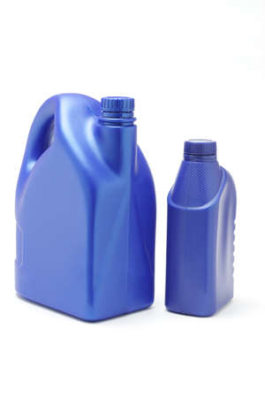 lubrication: Plastic containers of lubrication oil on white background