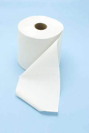 White toilet roll on seamless blue background photo