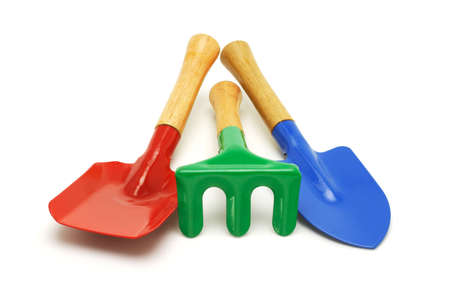 Colorful kids garden tools on white background photo
