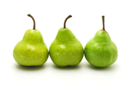 Ripening green pears arranged on white background photo