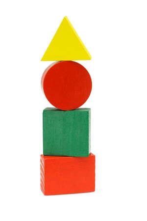 cilindro: Pila de bloques de madera geometic sobre fondo blanco Foto de archivo