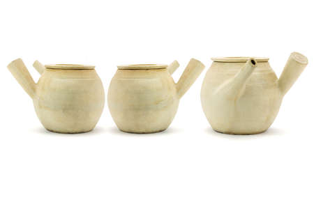Three Chinese clay pots arranged on white background photo