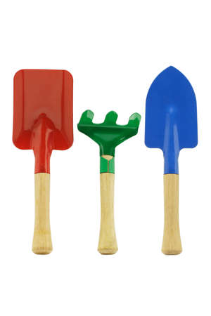 spud: Colorful kids garden tools on white background