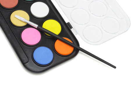 Watercolor paint set with brush on white background photo