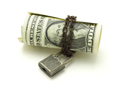 commercial law: US dollars chained and locked on white background