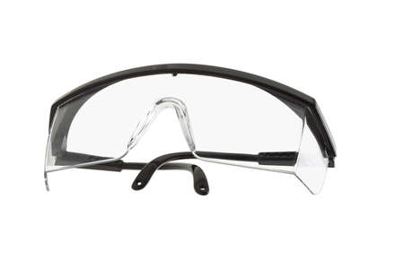 protecting spectacles: Plastic safety goggles on white background